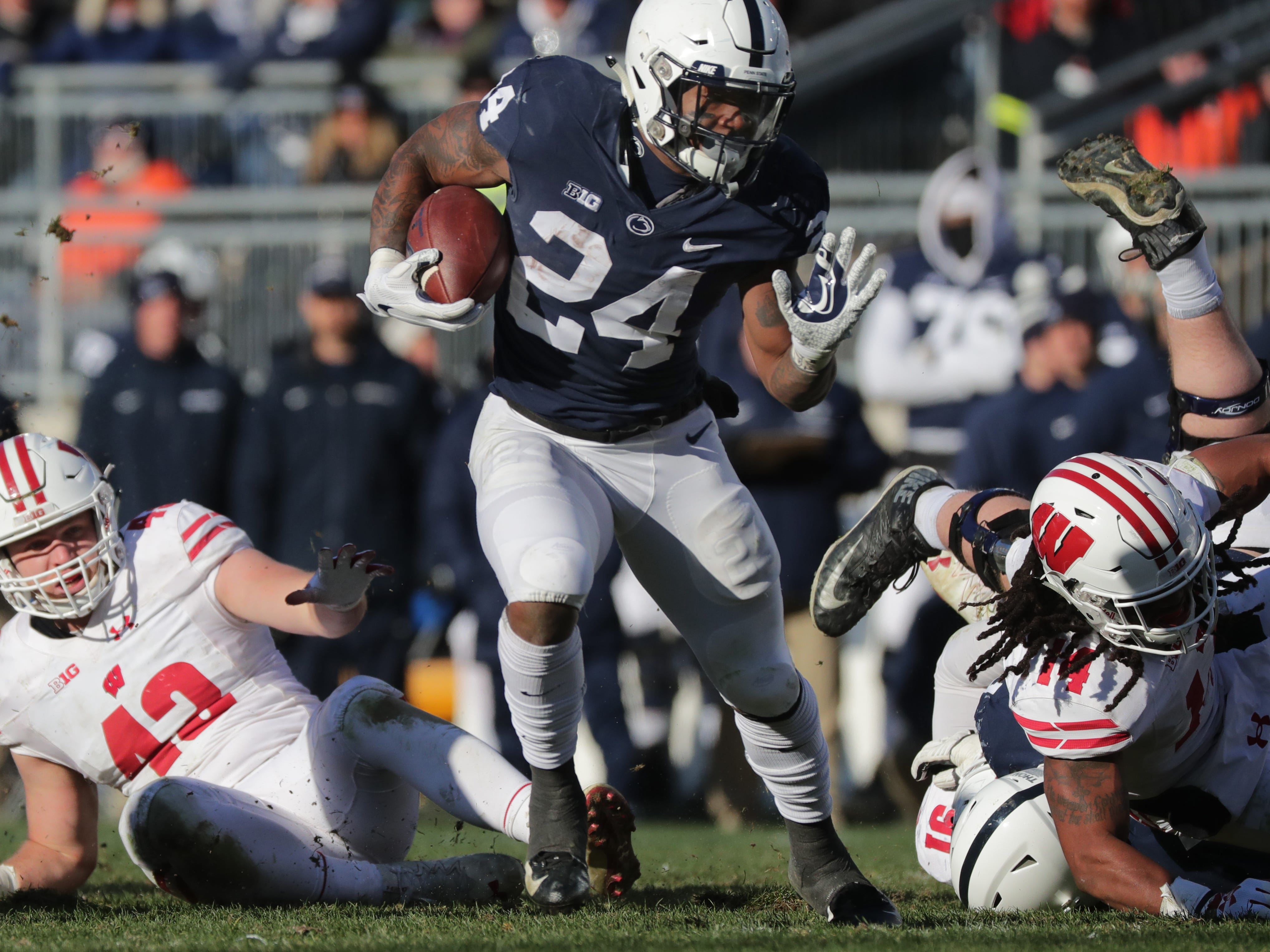 Penn State running back Miles Sanders runs through the Wisconsin defense during the fourth quarter Saturday.