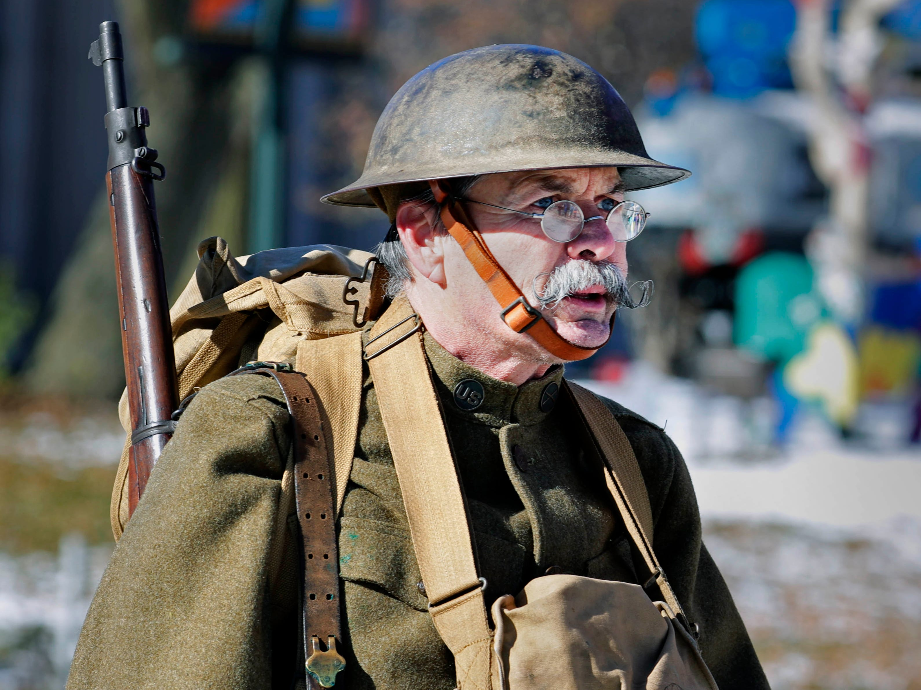 A parade participant is seen dressed as an American World War I soldier.