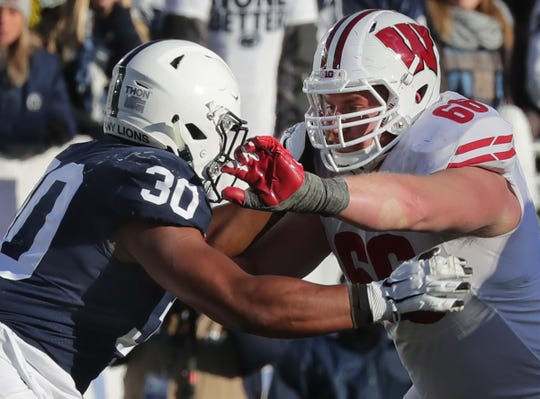 Wisconsin offensive lineman Beau Benzschawel blocks Penn State defensive tackle Kevin Givens during the fourth quarter Saturday.