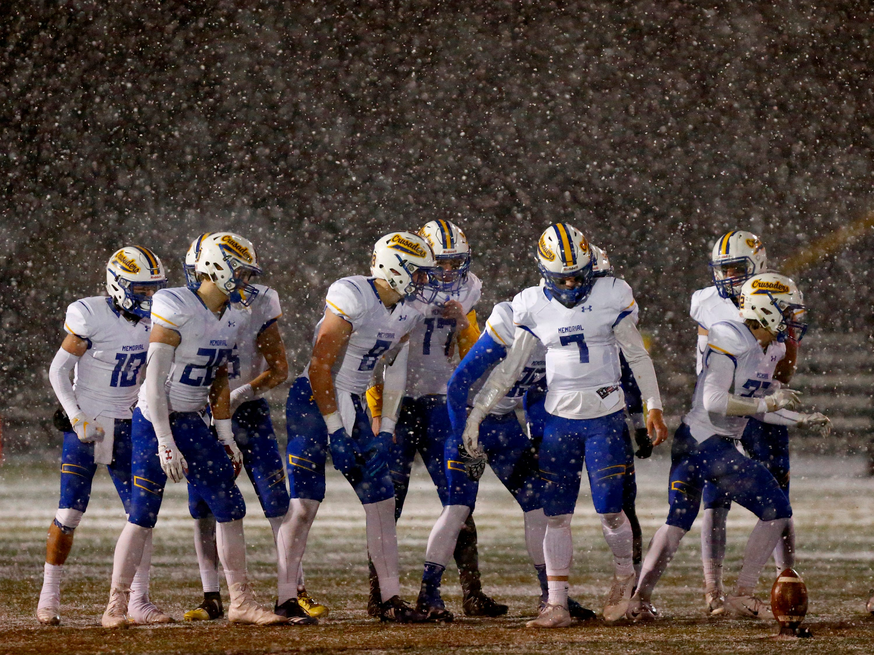 Catholic Memorial sets up for a kickoff in a swirl of snow during WIAA Division 3 Level 4 play against New Berlin Eisenhower Nov. 9 at Kettle Moraine. The Crusaders defeated the Lions, 41-14, to punch their ticket to the state title game.