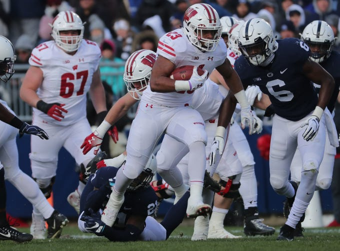 Wisconsin running back Jonathan Taylor burst through the Penn State defense en route to a 71-yard touchdown run during the first quarter Saturday at Beaver Stadium in State College, Penn.