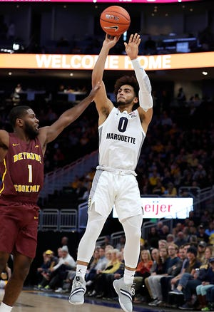 Marquette Golden Eagles guard Markus Howard shoots a three-pointer against Bethune-Cookman Wildcats guard Malik Maitland on Saturday. Howard finished with 37-points in the game.