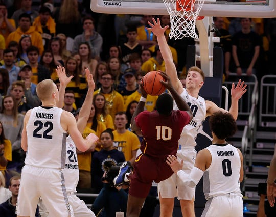 Golden Eagles forward Sam Hauser blocks a shot by Bethune-Cookman forward Cletrell Pope at in a game this season at Fiserv Forum.