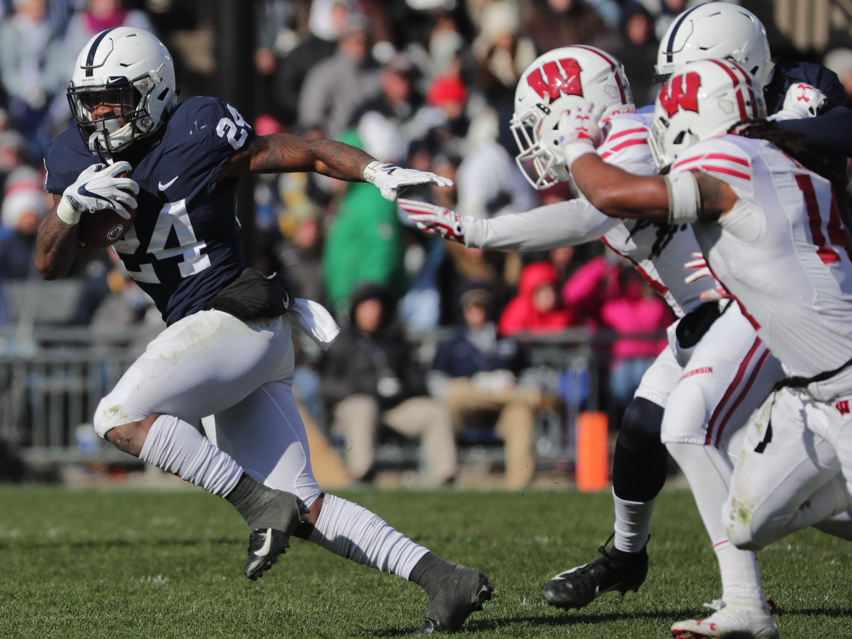 Penn State running back Miles Sanders turns the corner on the Wisconsin defense on Saturday.
