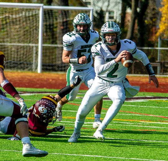 Montville QB Michael Burke (2) breaks free from Summit's Ollie Paasonen (15) in the NJSIAA SemiFinal North 2 Group III football matchup at Summit, November 10, 2018.