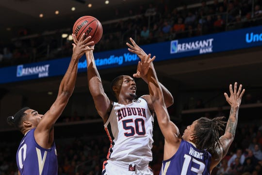 Auburn center Austin Wiley (50) shoots against Washington on Friday, November 9, 2018, in Auburn, Ala.