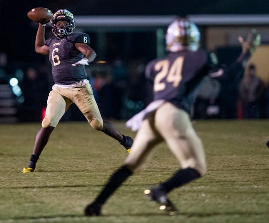 Wetumpka's Tyquan Rawls (6) throws to Dvenio Davis (24) against Daphne at Hohenburg Field in Wetumpka, Ala., on Friday November 9, 2018.