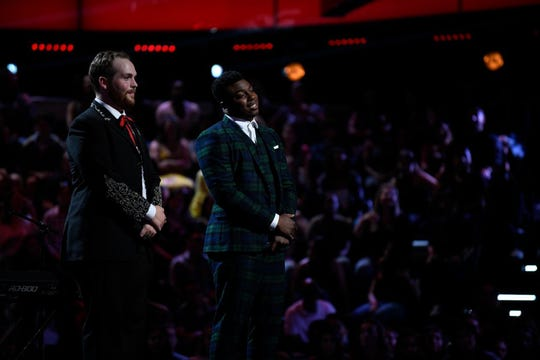 """Albertville native Colton Smith, left, and Montgomery resident and Bay Minette native Kirk Johnson hear from the coaches during their knockout round on """"The Voice."""""""
