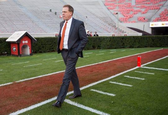 Auburn head coach Gus Malzahn walks the field at Sanford Stadium in Athens, Ga., on Saturday, Nov. 10, 2018.