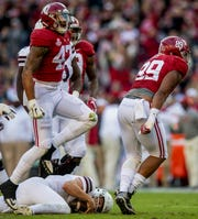 Alabama defensive lineman LaBryan Ray (89) and linebacker Christian Miller (47) celebrate sacking  Mississippi State quarterback Nick Fitzgerald (7) in first half action at Bryant Denny Stadium in Tuscaloosa, Ala., on Saturday November 9, 2018.