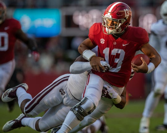 Alabama quarterback Tua Tagovailoa (13) carries the ball against Mississippi State University in first half action at Bryant Denny Stadium in Tuscaloosa, Ala., on Saturday November 9, 2018.