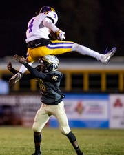 Daphne's. Christian Williams (4) leaps over Wetumpka's Devonta Jerido (16) at Hohenburg Field in Wetumpka, Ala., on Friday November 9, 2018. Hurdling is a penalty in high school.