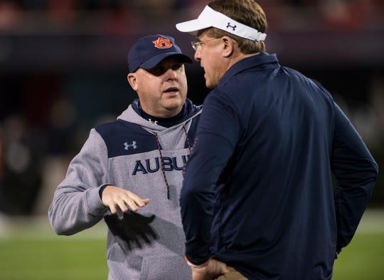 Auburn offensive coordinator Chip Lindsey and Auburn head coach Gus Malzahn talk as the their team warms up before taking on Georgia at Sanford Stadium in Athens, Ga., on Saturday, Nov. 10, 2018.