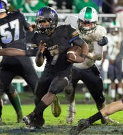 Catholic's Darrell Gibson runs the ball against Holtville.