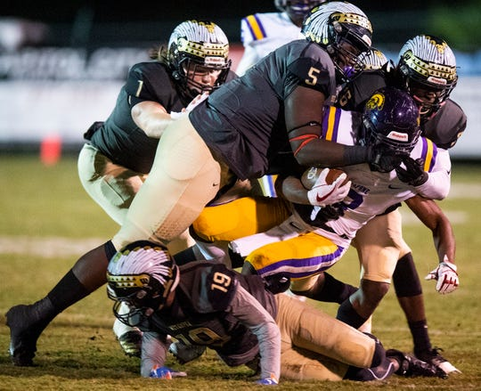 Wetumpka's Patrick Lucas (5) stops Daphne's Cameron Young (3) at Hohenburg Field in Wetumpka, Ala., on Friday November 9, 2018.