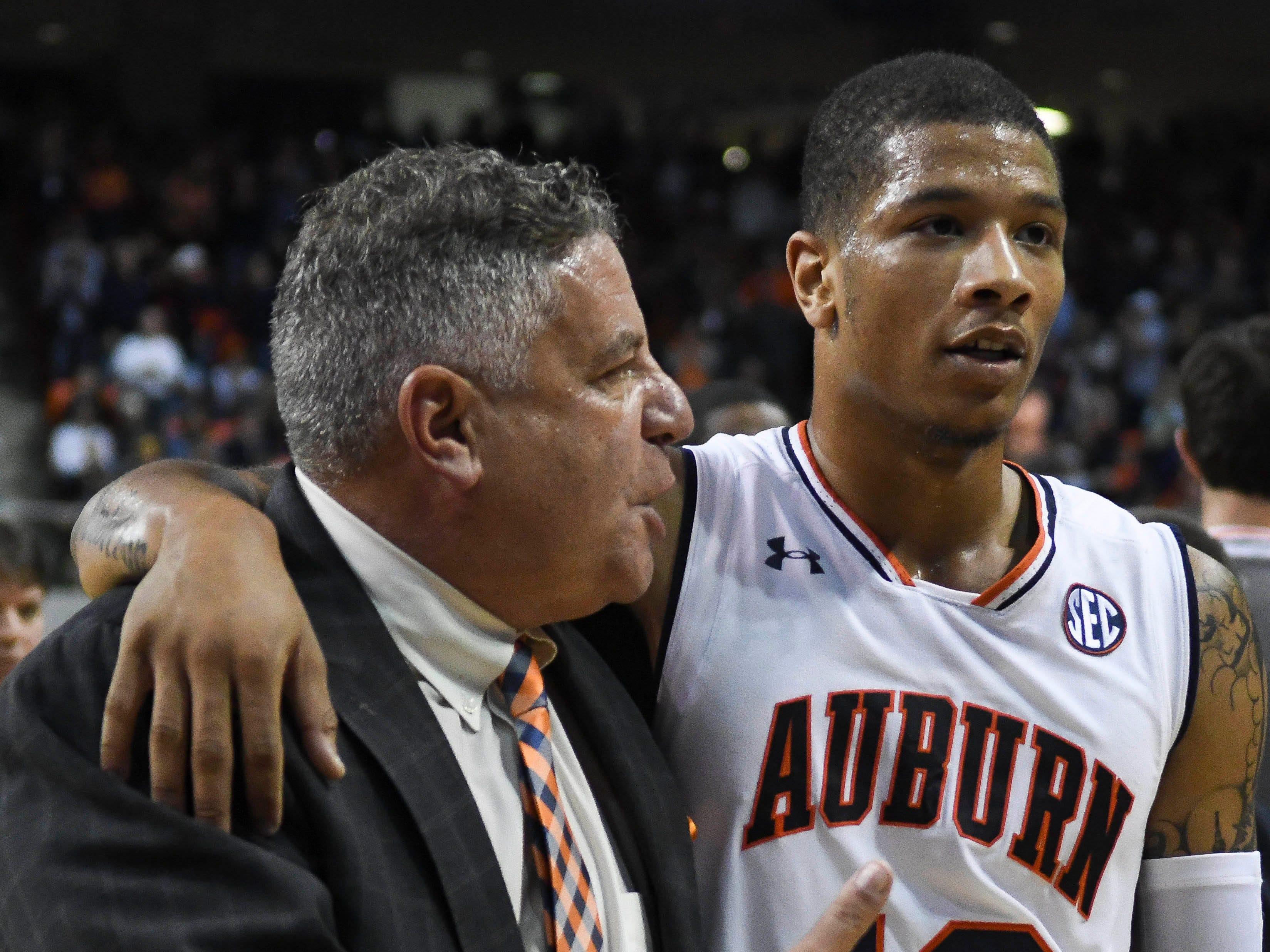 Nov 9, 2018; Auburn, AL, USA; Auburn Tigers head coach Bruce Pearl talks with Auburn Tigers guard Samir Doughty (10) at halftime against the Washington Huskies at Auburn Arena. Mandatory Credit: Julie Bennett-USA TODAY Sports