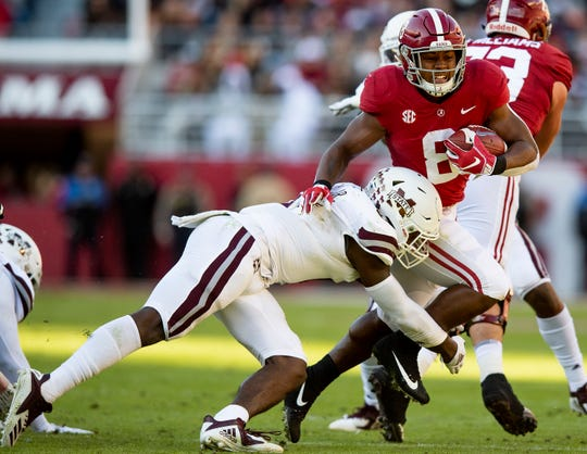 Alabama running back Josh Jacobs (8) tries to break the tackle of Mississippi State linebacker Willie Gay, Jr., (6) in first half action at Bryant Denny Stadium in Tuscaloosa, Ala., on Saturday November 9, 2018.