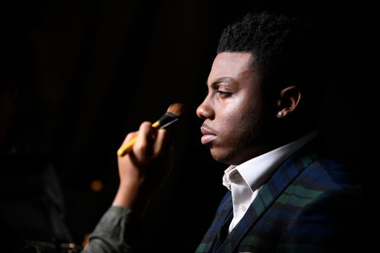 """Montgomery resident Kirk Jay gets a touch of stage makeup during """"The Voice."""""""