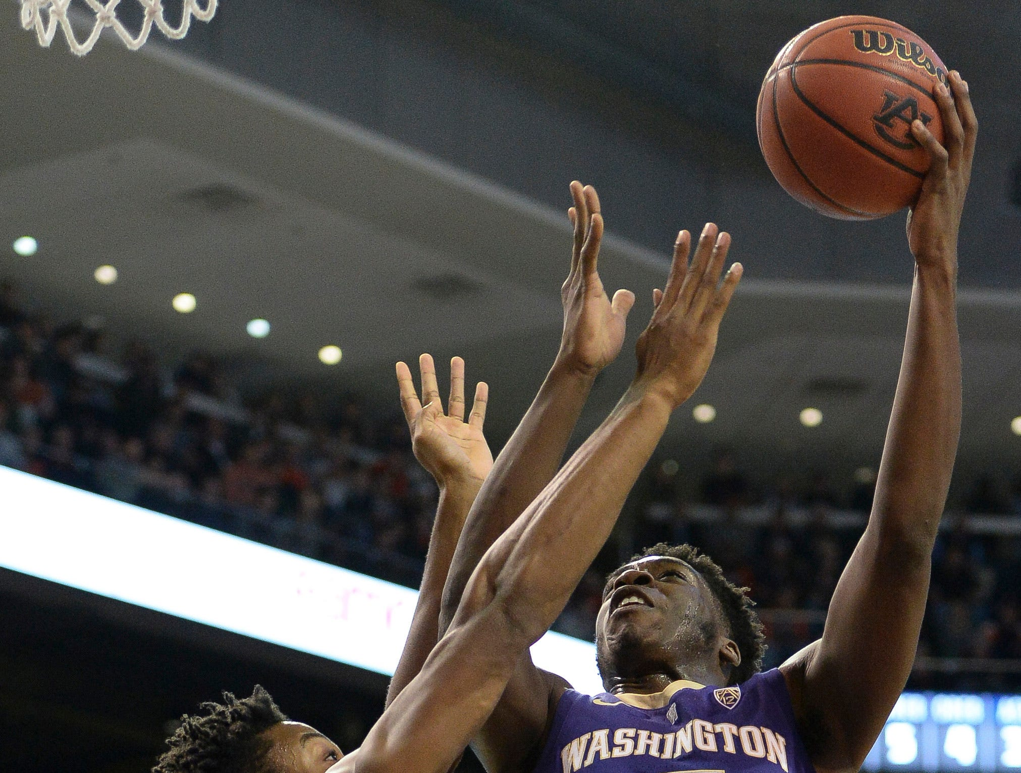 Nov 9, 2018; Auburn, AL, USA; Washington Huskies forward Noah Dickerson (15) shoots over Auburn Tigers forward Anfernee McLemore (24) at Auburn Arena. Mandatory Credit: Julie Bennett-USA TODAY Sports
