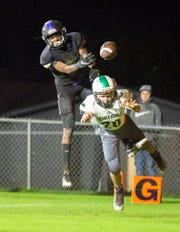 Catholic's Derrick Parker misses the interception while Holtville's Michael Watson misses what would have been a touchdown pass.