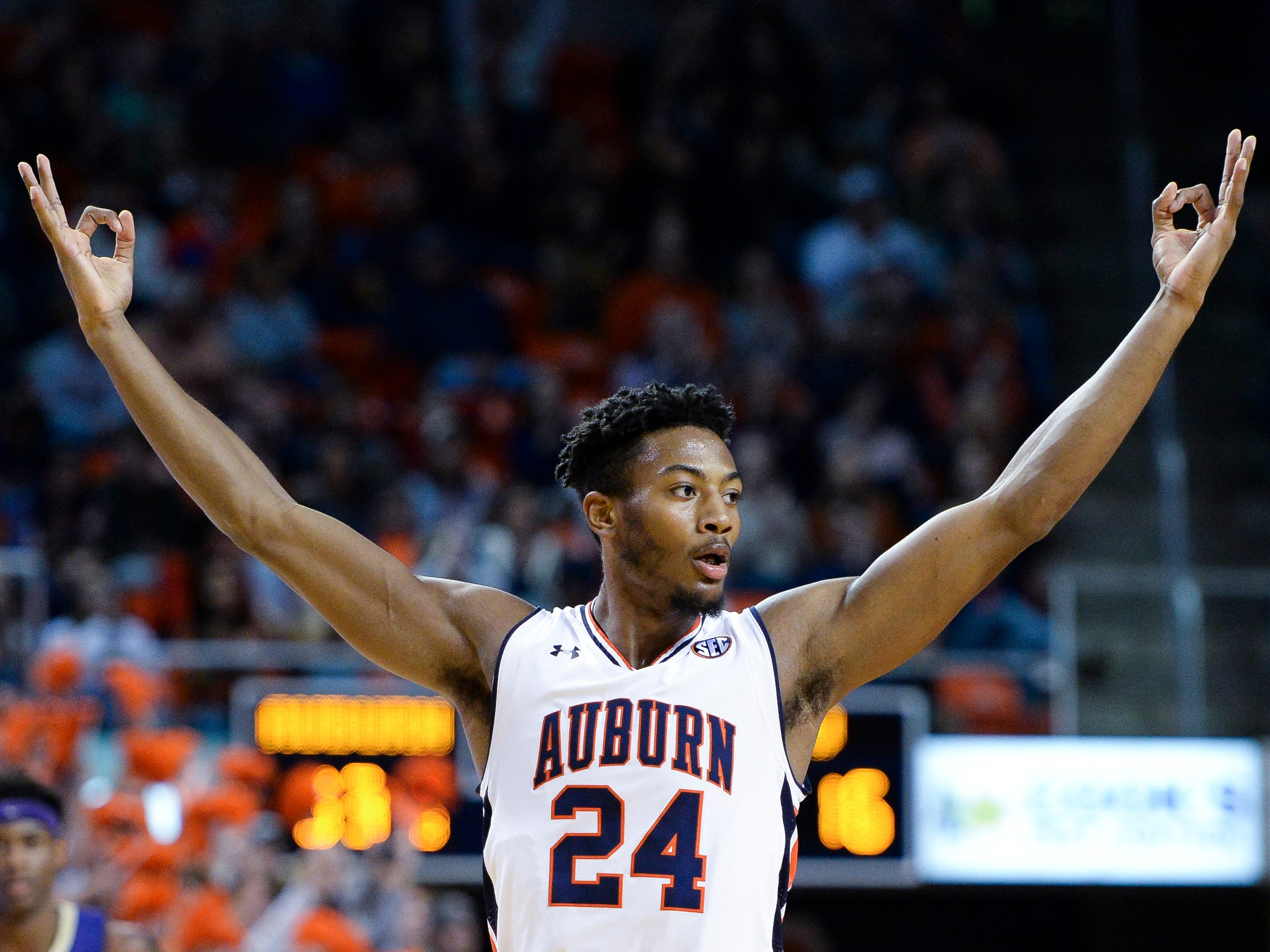 Auburn forward Anfernee McLemore (24) celebrates after scoring against Washington at Auburn Arena on Nov. 9, 2018, in Auburn, Ala.