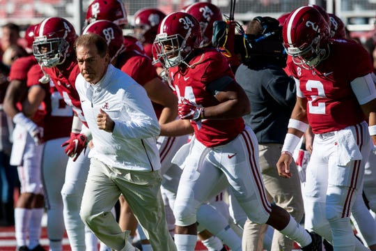 Alabama head coach Nick Saban lead his team onto the field before the Alabama vs. Mississippi State game at Bryant Denny stadium in Tuscaloosa, Ala., on Saturday November 9, 2018.