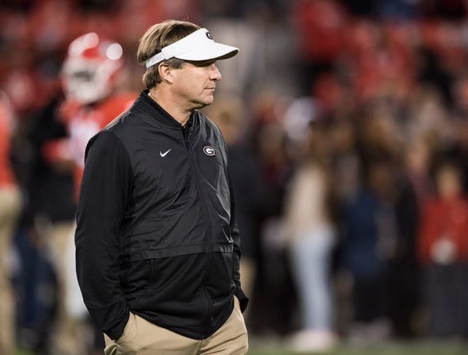 Georgia head coach Kirby Smart watches on as his team warms up before taking on Auburn at Sanford Stadium in Athens, Ga., on Saturday, Nov. 10, 2018.