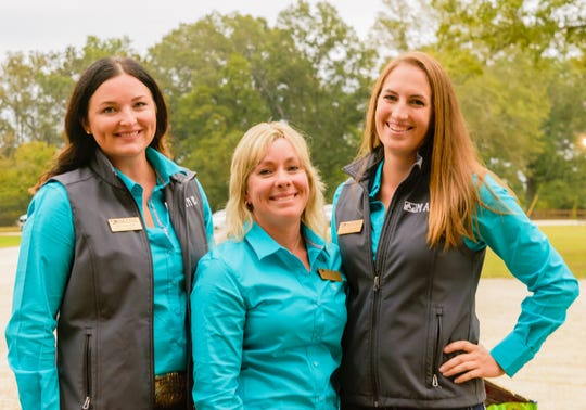 MANE's staff Jessica Von Gal, Tiffany Atkinson and Abby Houchin prepared the therapeutic riding center for all to have the evening.
