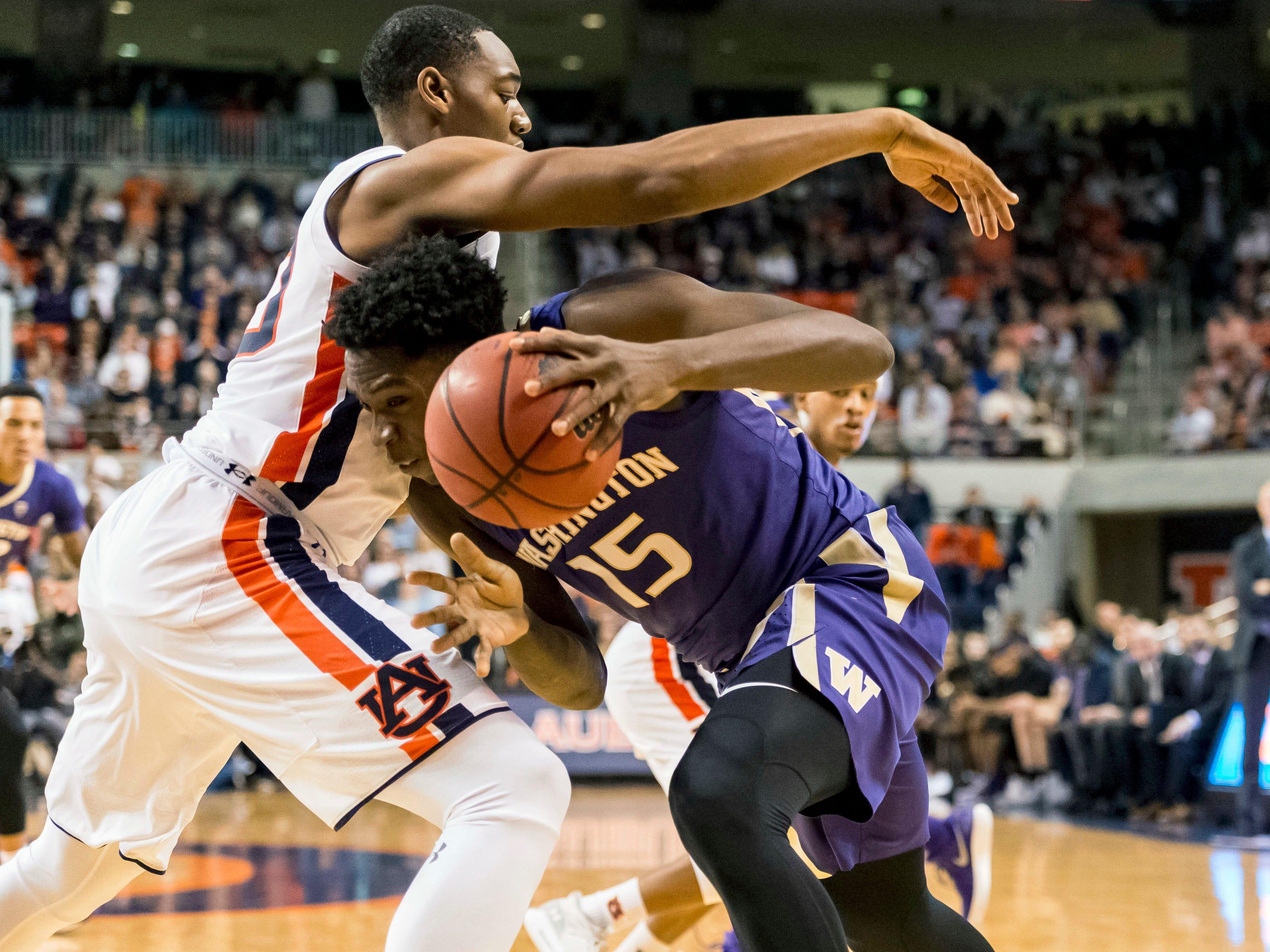 Washington forward Noah Dickerson (15) challenges Auburn center Austin Wiley (50) on Friday, Nov. 9, 2018, in Auburn, Ala.