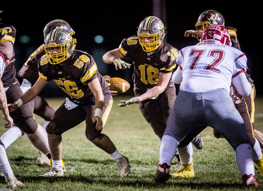 Monore Central faces off against Adams Central during their regional at Monroe Central High School Friday, Nov. 9, 2018.