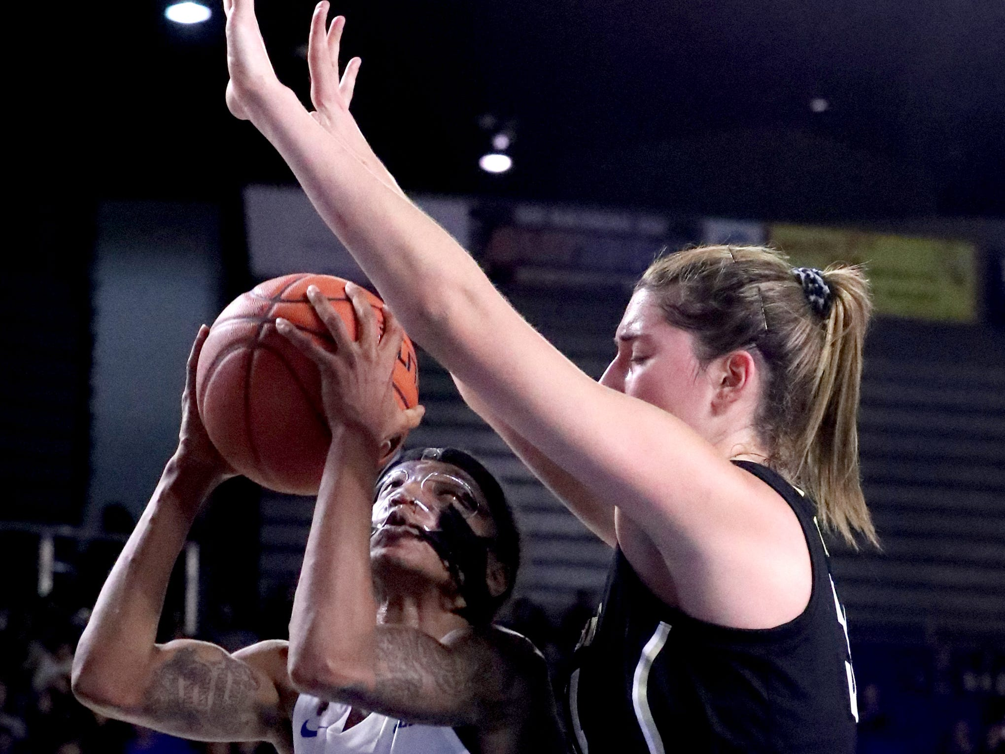 MTSU's A'Queen (1) goes up for a shot as Vanderbilt's Mariella Fasoula (34) guards her during the women's home opening game at MTSU on Friday, Nov. 8, 2018.