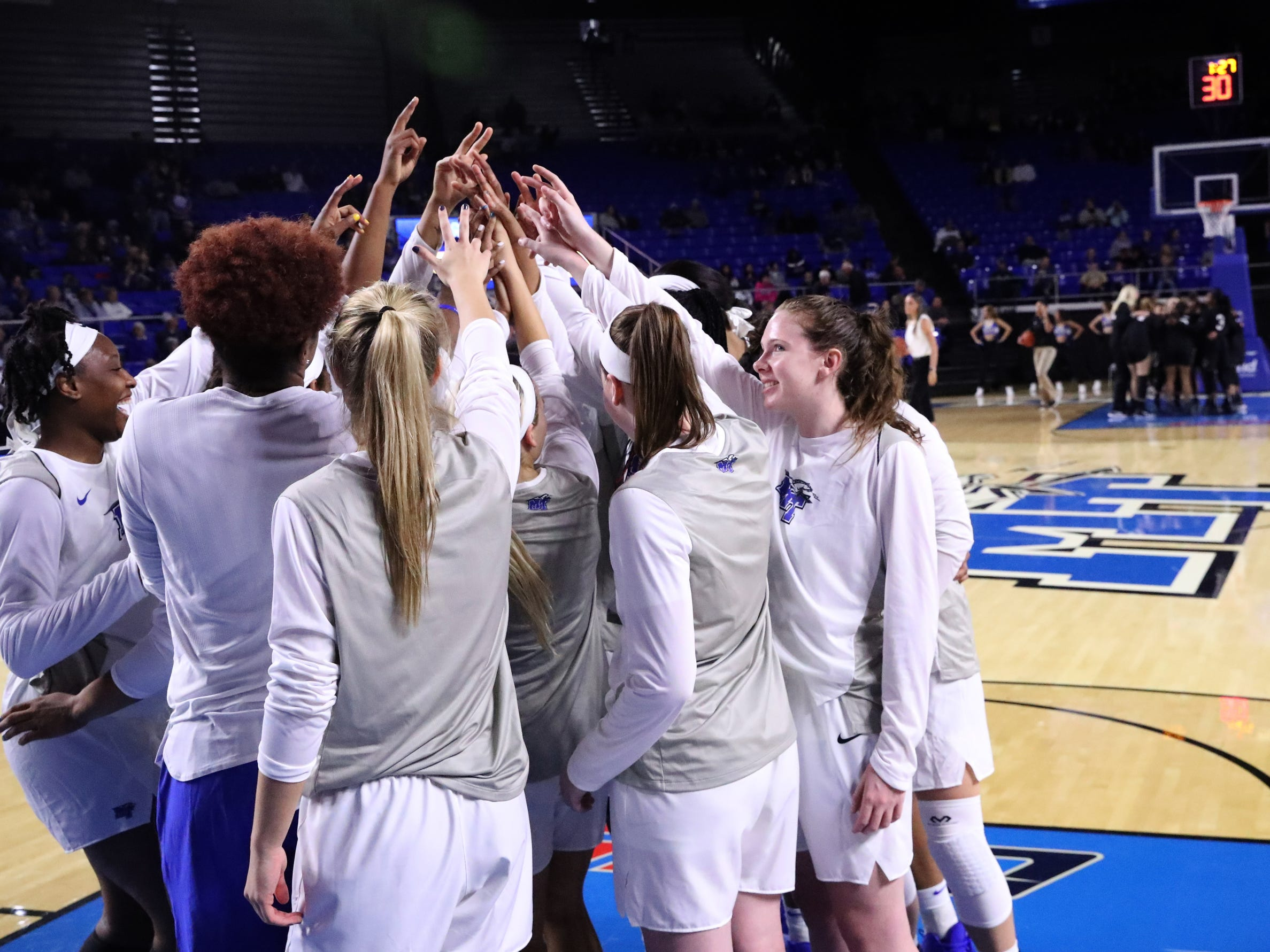 MTSU's players gather together on the floor before their home opener against Vanderbilt at MTSU on Friday, Nov. 8, 2018.