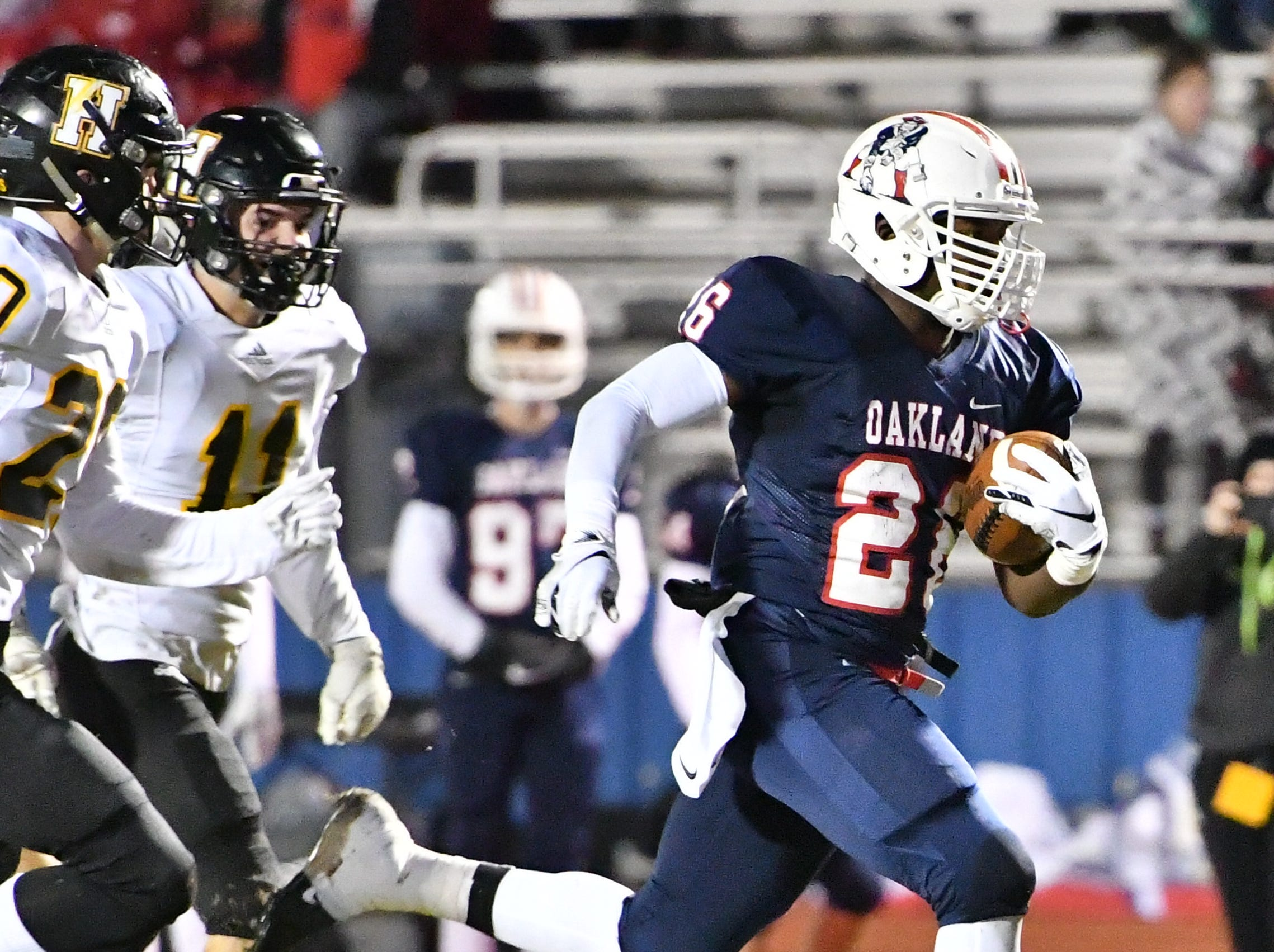 Oakland's Xavier Myers scores his first TD of the night Friday night against Hendersonville.