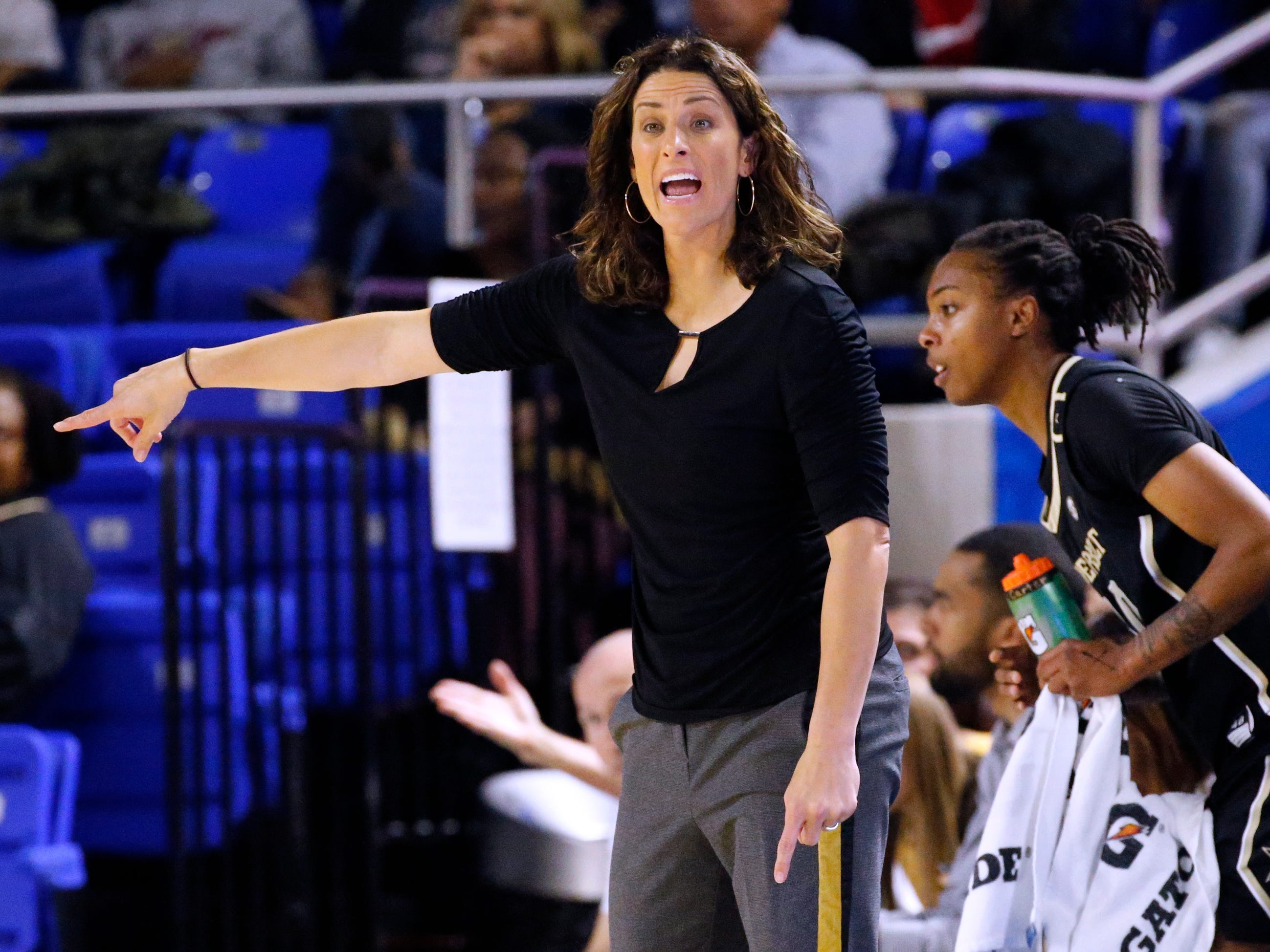 Vanderbilt's head coach Stephanie White instructs players on the sidelines during MTSU women's home opening game at MTSU on Friday, Nov. 8, 2018.