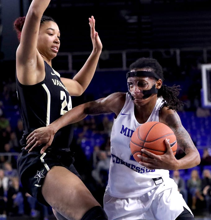 MTSU's A'Queen Hayes (1) pushes around Vanderbilt's Autumn Newby (24) to the basket during the women's home opening game at MTSU on Friday, Nov. 8, 2018.