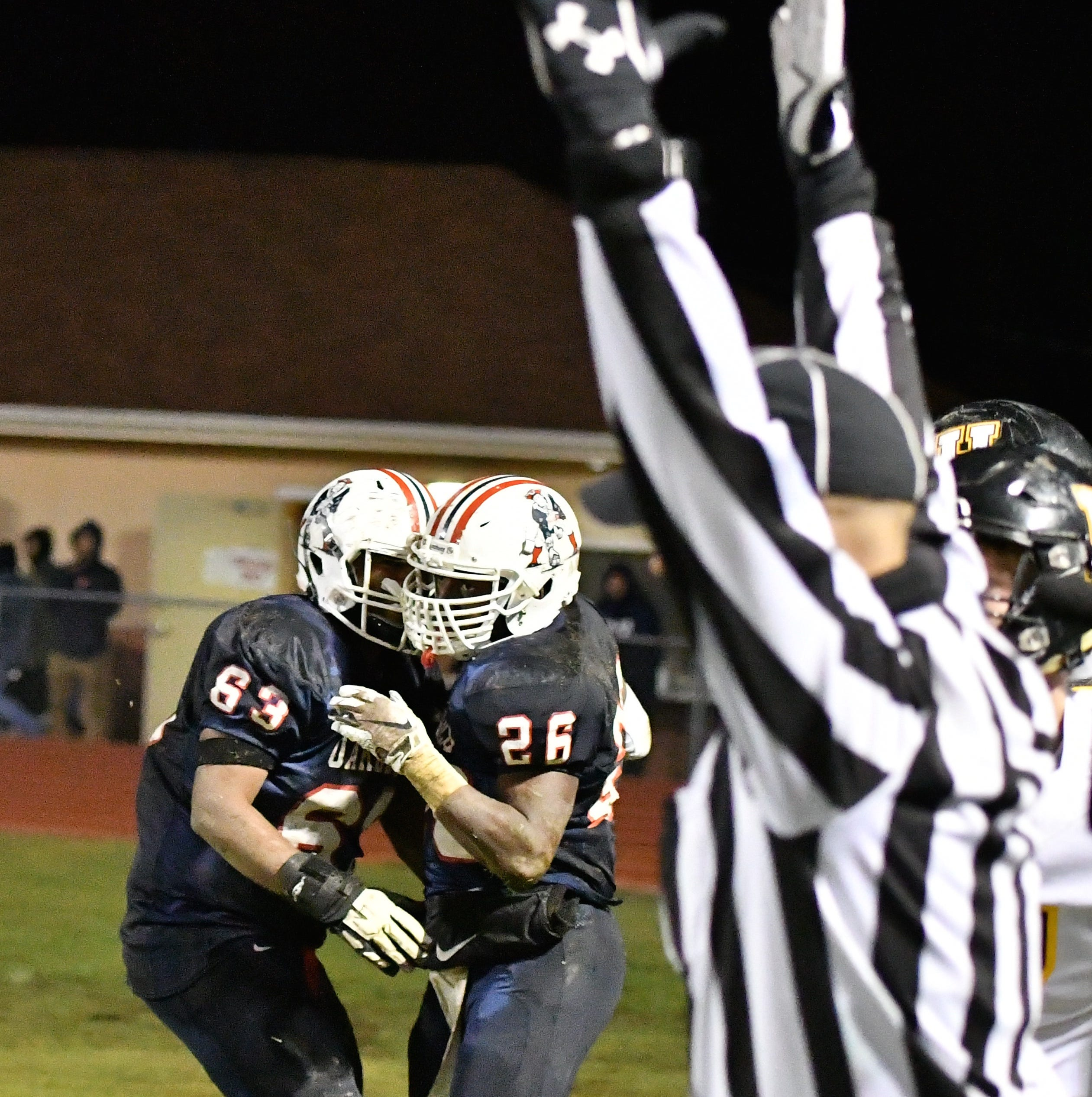Oakland's Xavier Myers celebrates his touchdown for Oakland with teammate Lionel Patterson Friday night against Hendersonville.