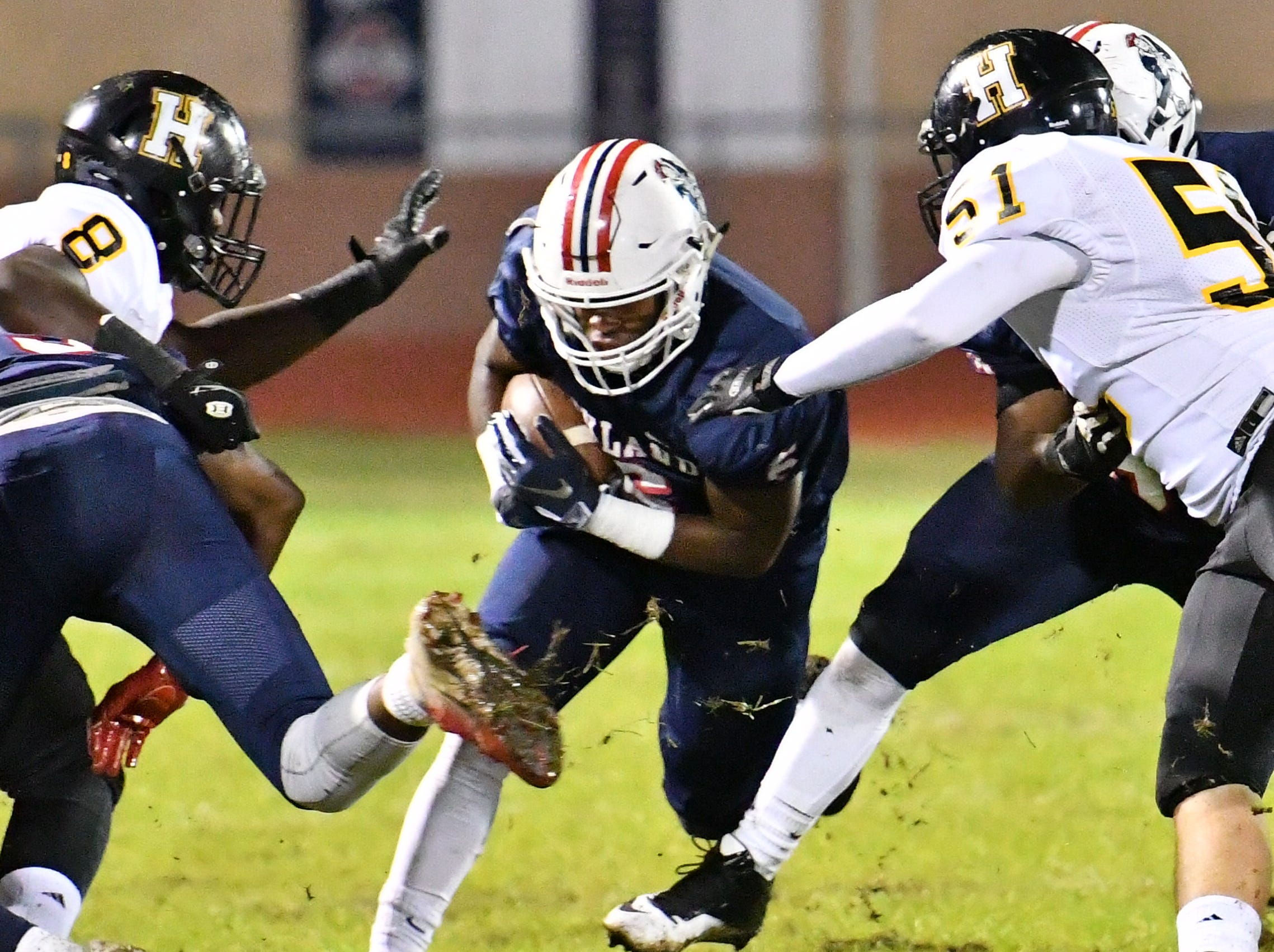 Oakland's Justin Jefferson finds a hole in the Hendersonville defense Friday night.