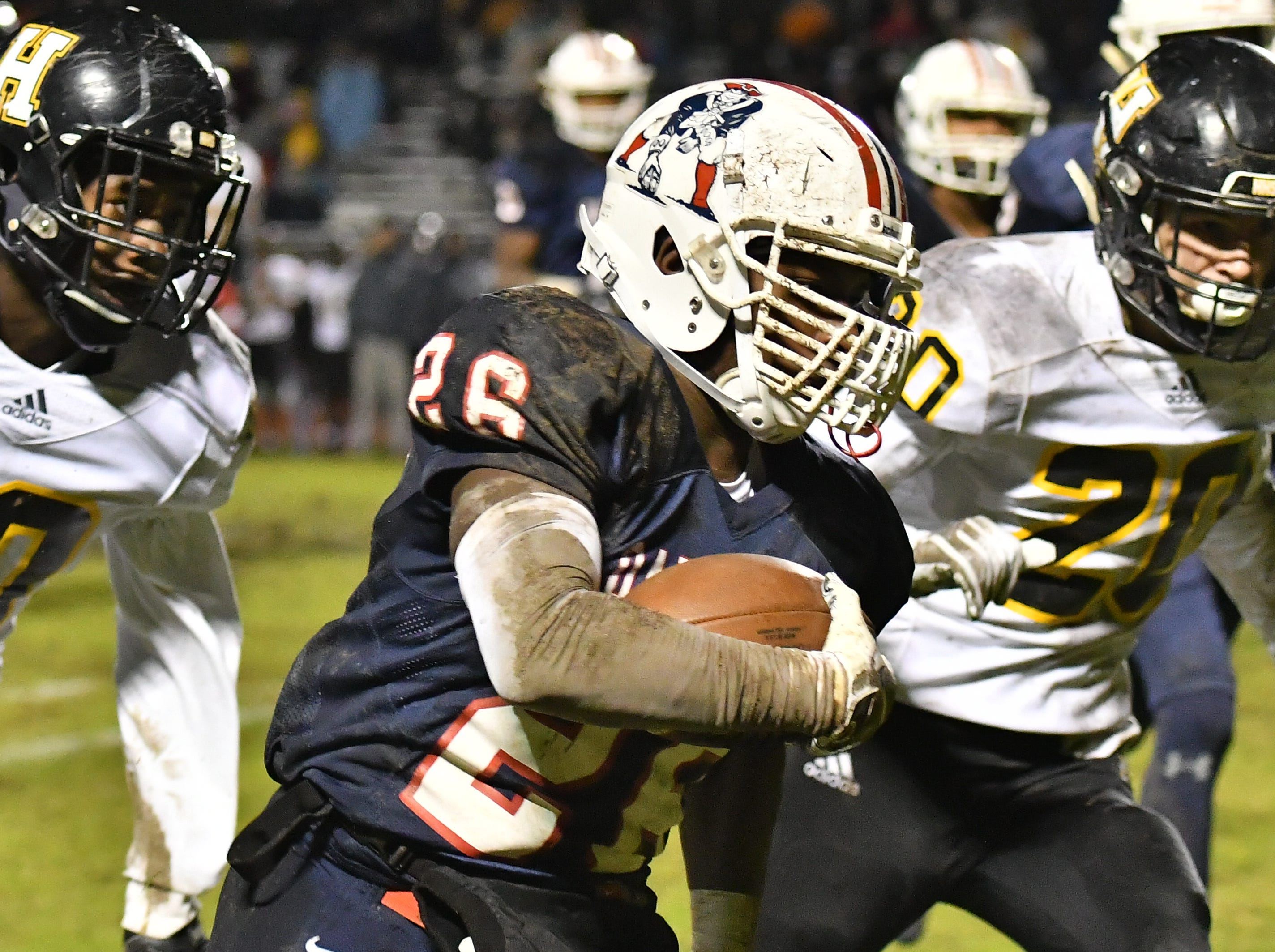 Oakland running back Xavier Myers rushes downfield against Hendersonville Friday night for a large gain.