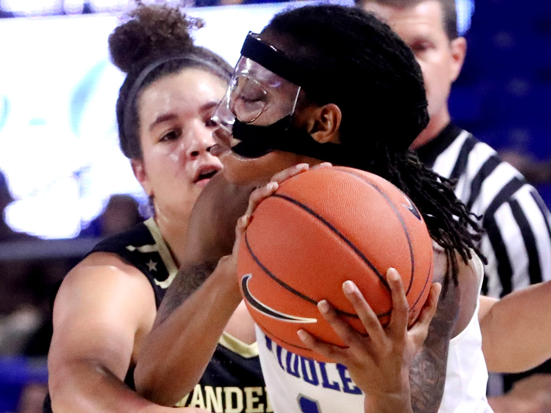 MTSU's A'Queen Hayes (1) looks to pass the ball as Vanderbilt's Kaleigh Clemons-Green (35) guards her during the women's home opening game at MTSU on Friday, Nov. 8, 2018.