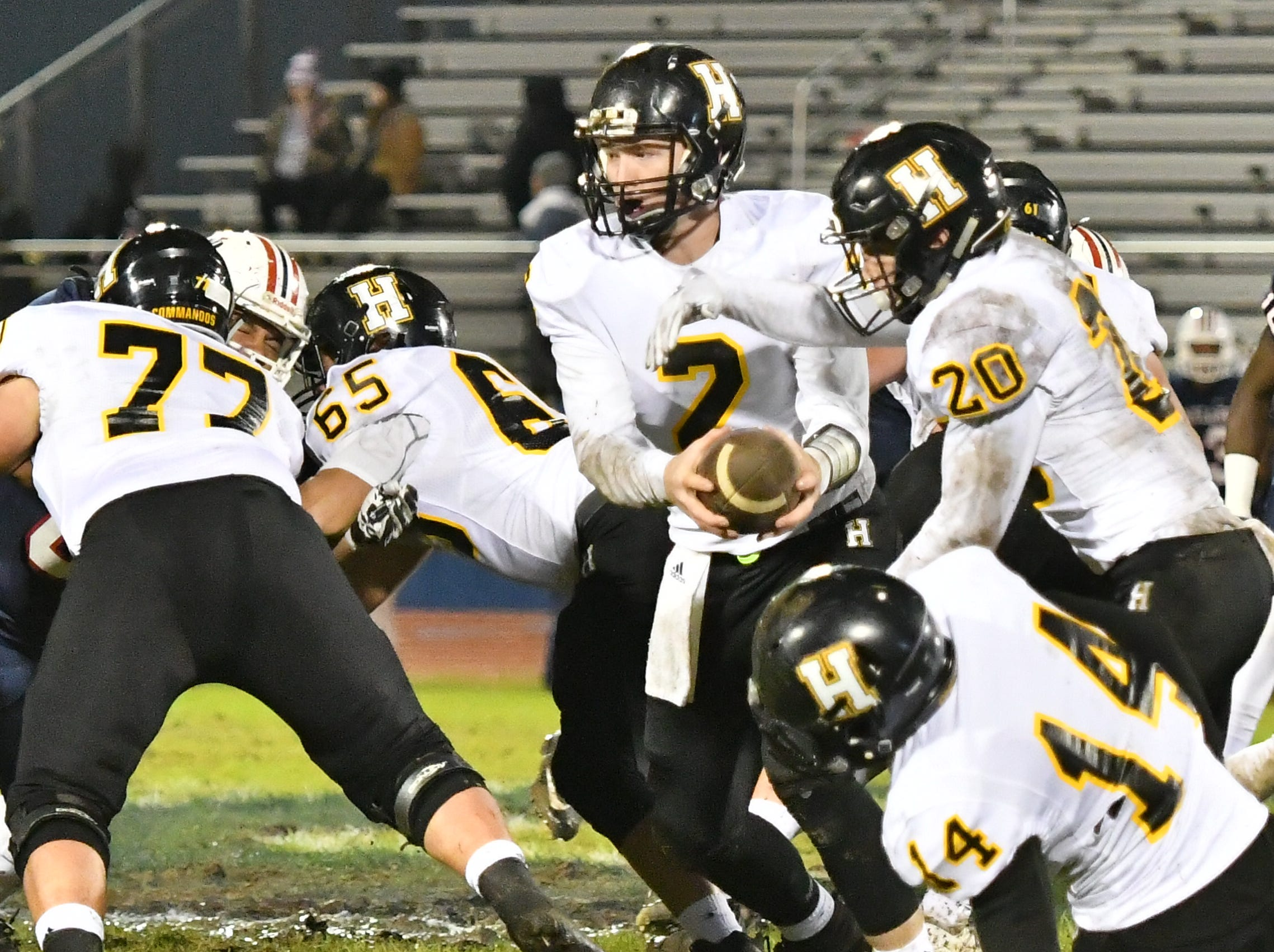 Hendersonville quarterback Drew Hohenbrink hands off to Nate Hancock against Oakland Friday night.