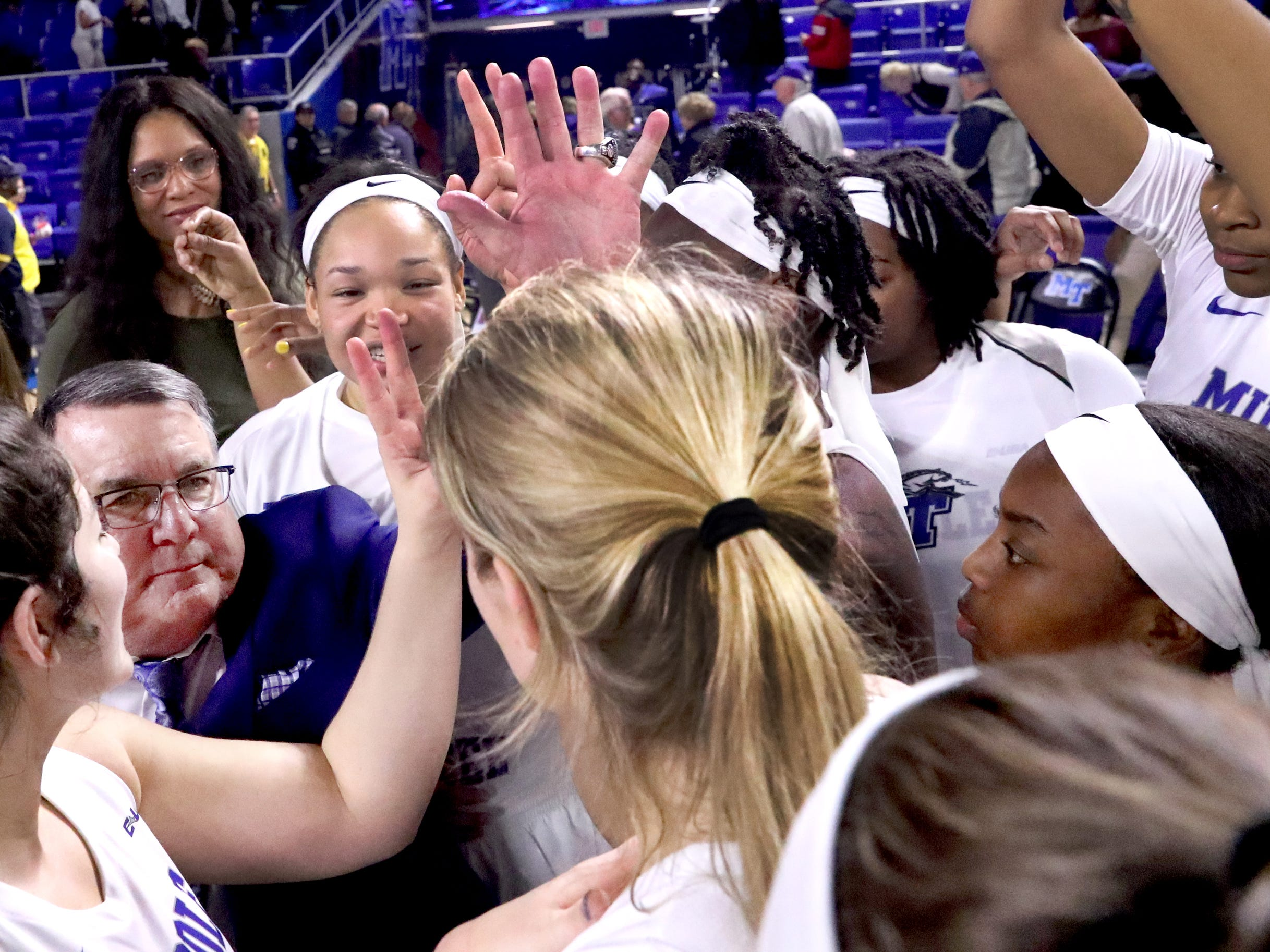 MTSU's head girls basketball Coach Rick Insell gathers with his team  to celebrate after beating Vanderbilt 65-58 during the women's home opening game at MTSU on Friday, Nov. 8, 2018.