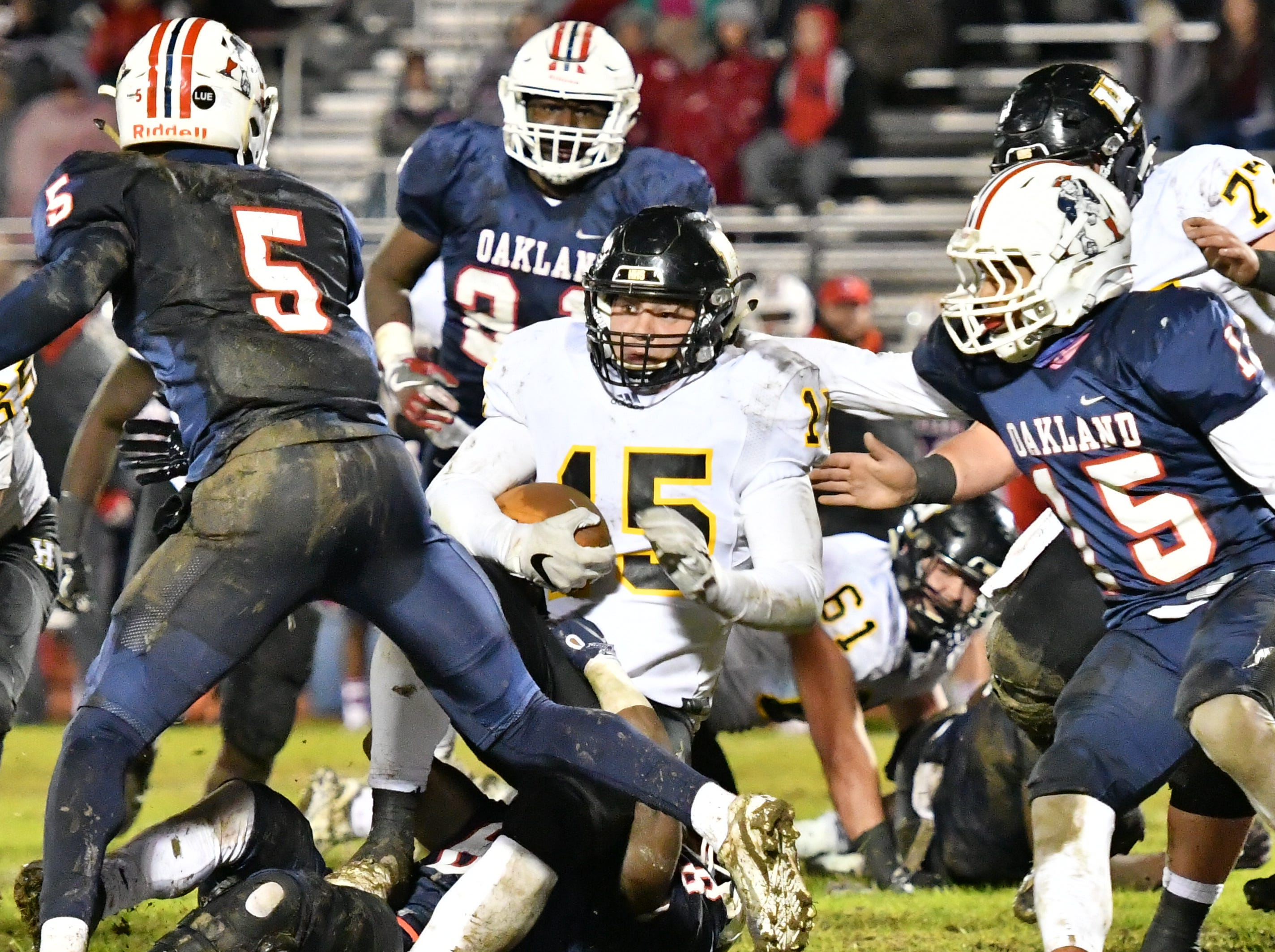 Hendersonville's Dalton Jones is brought down by the Oakland defense Friday night.