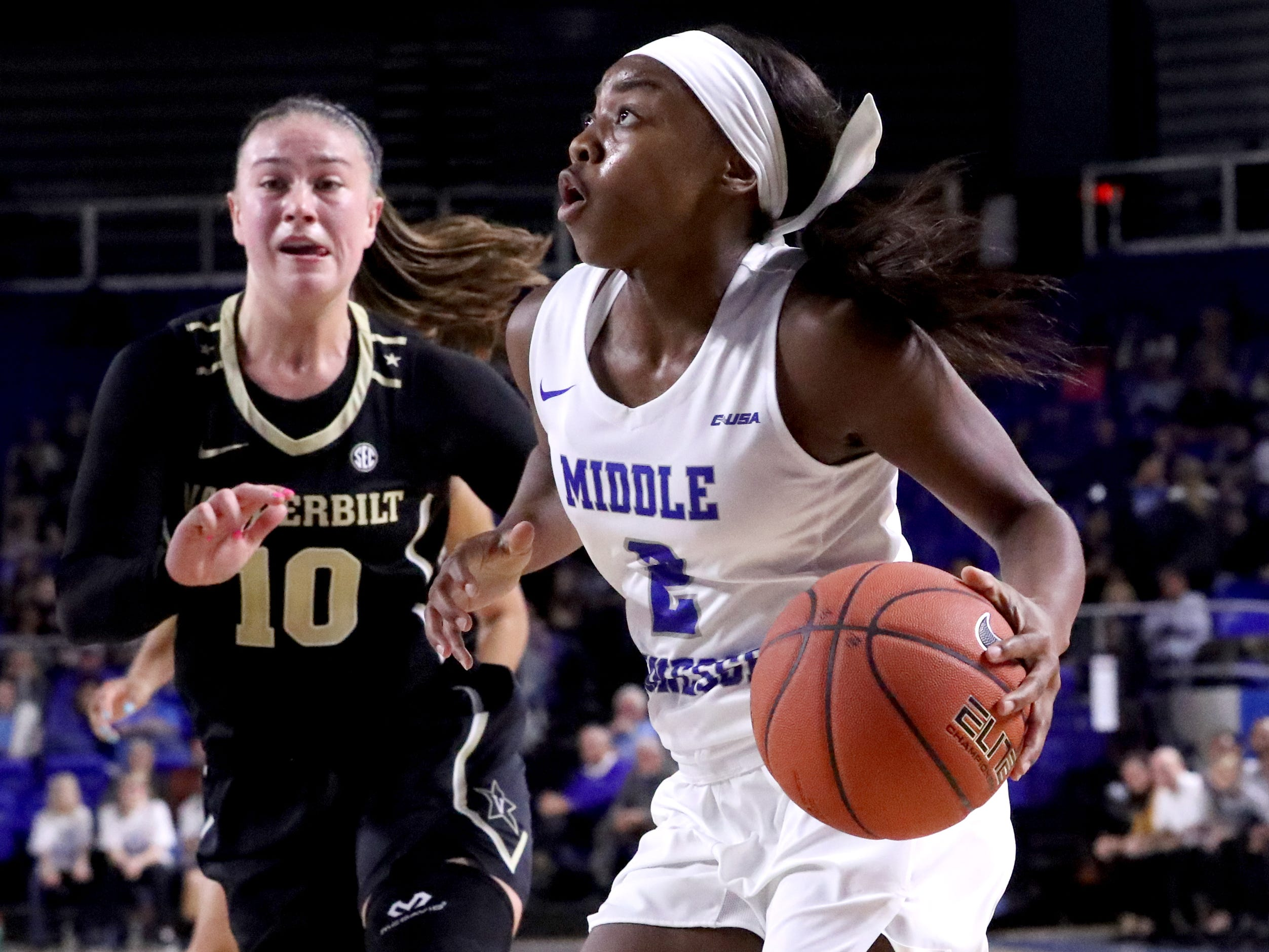 MTSU's Taylor Sutton (2) pushes toward the basket as Vanderbilt's Cierra Walker (10) comes up to defend her during MTSU women's home opening game at MTSU on Friday, Nov. 8, 2018.