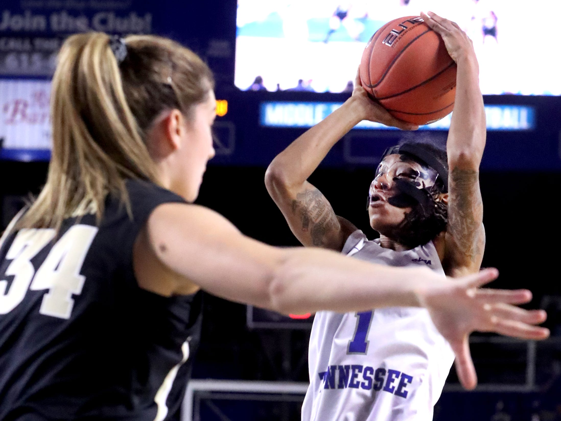 MTSU's A'Queen Hayes (1) goes up for a shot as Vanderbilt's Mariella Fasoula (34) guards her during the women's home opening game at MTSU on Friday, Nov. 8, 2018.