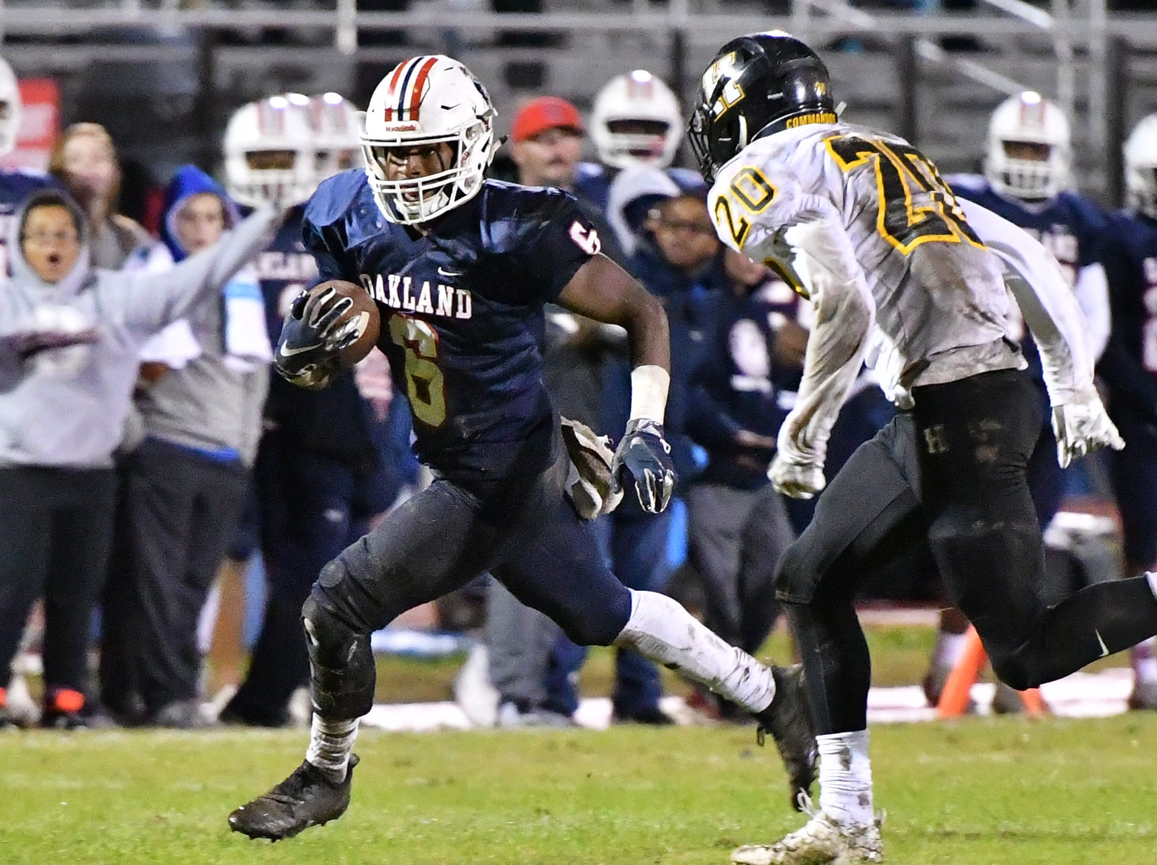 Oakland's Justin Jefferson runs downfield after a pass reception against Hendersonville Friday night.