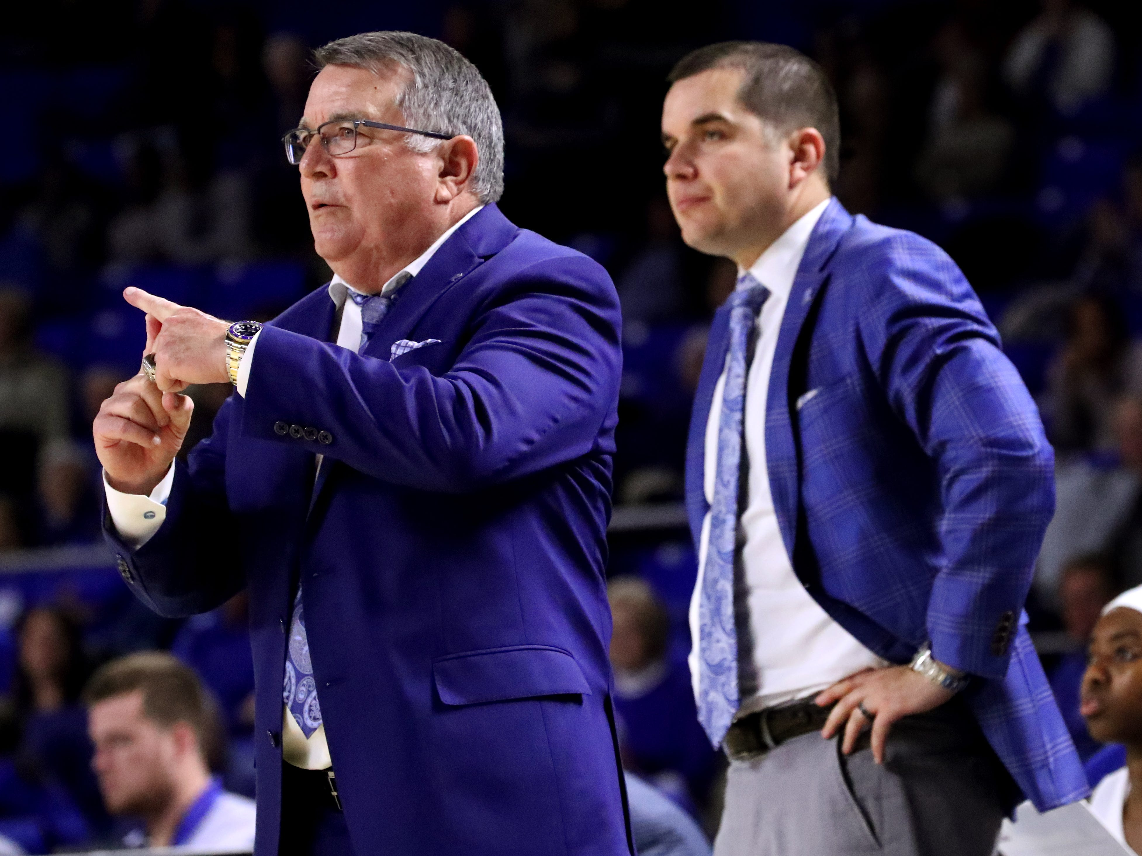 MTSU's head basketball coach Rick Insell, left coaches as his son and assistant MTSU basketball coach Matt Insell stands up in the background during the game against Vanderbilt during MTSU women's home opening game at MTSU on Friday, Nov. 8, 2018.