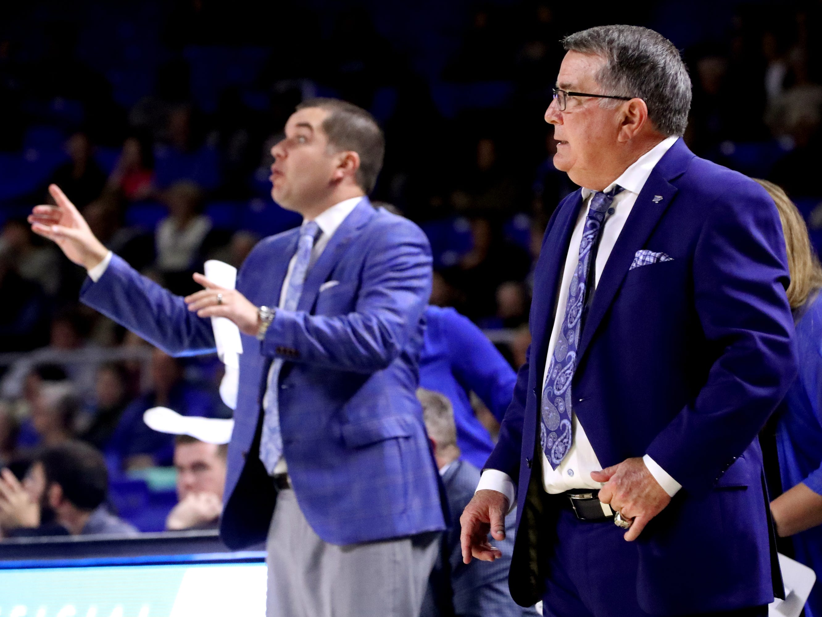 MTSU's head Coach Rick Insell, right, watches the game from the sidelines as his son assistant Coach Matt Insell also coaches from the sidelines during the game against Vanderbilt at MTSU on Friday, Nov. 8, 2018.