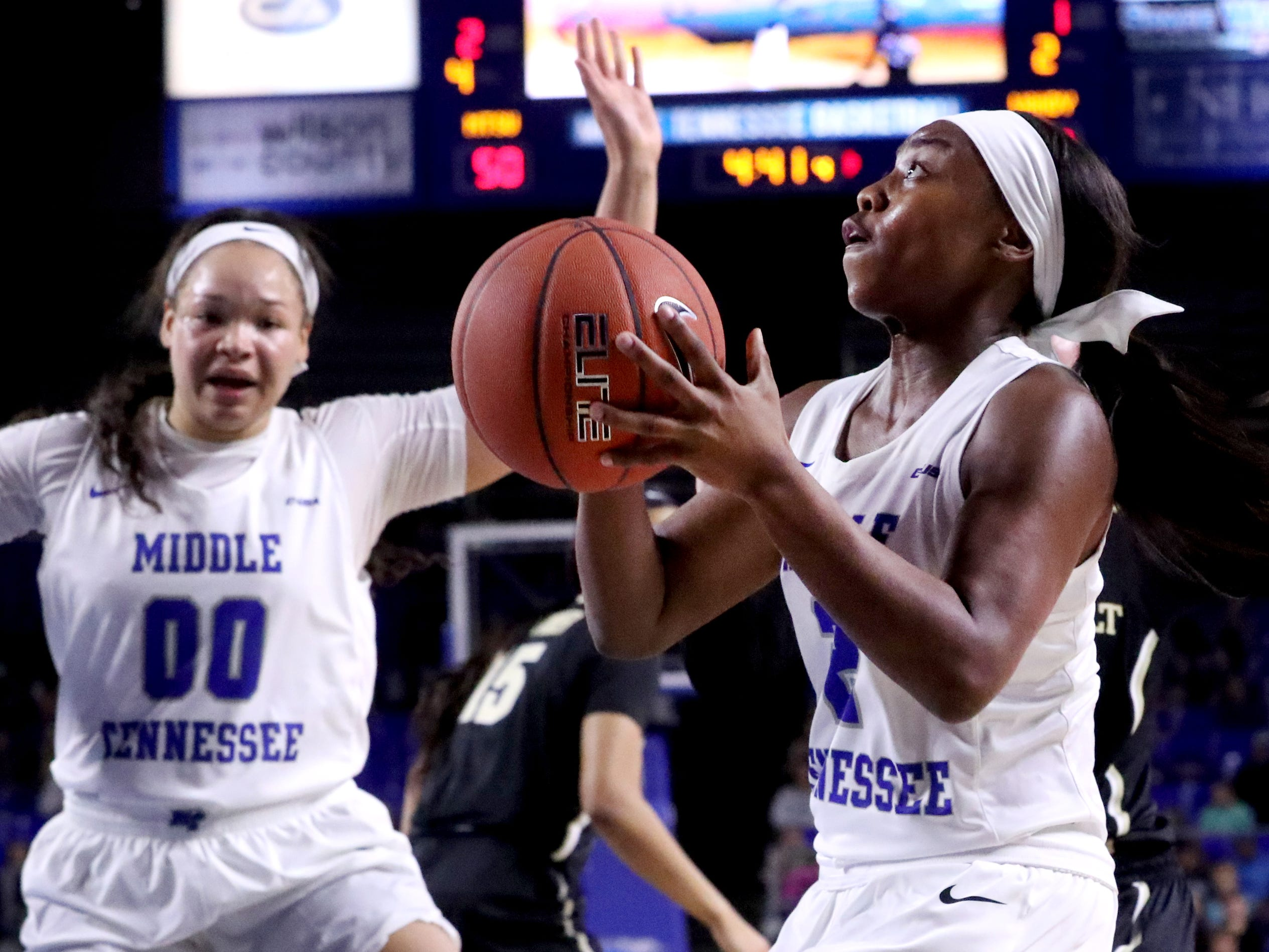 MTSU's Taylor Sutton (2) goes up for a shot during the game against Vanderbilt during MTSU women's home opening game at MTSU on Friday, Nov. 8, 2018.