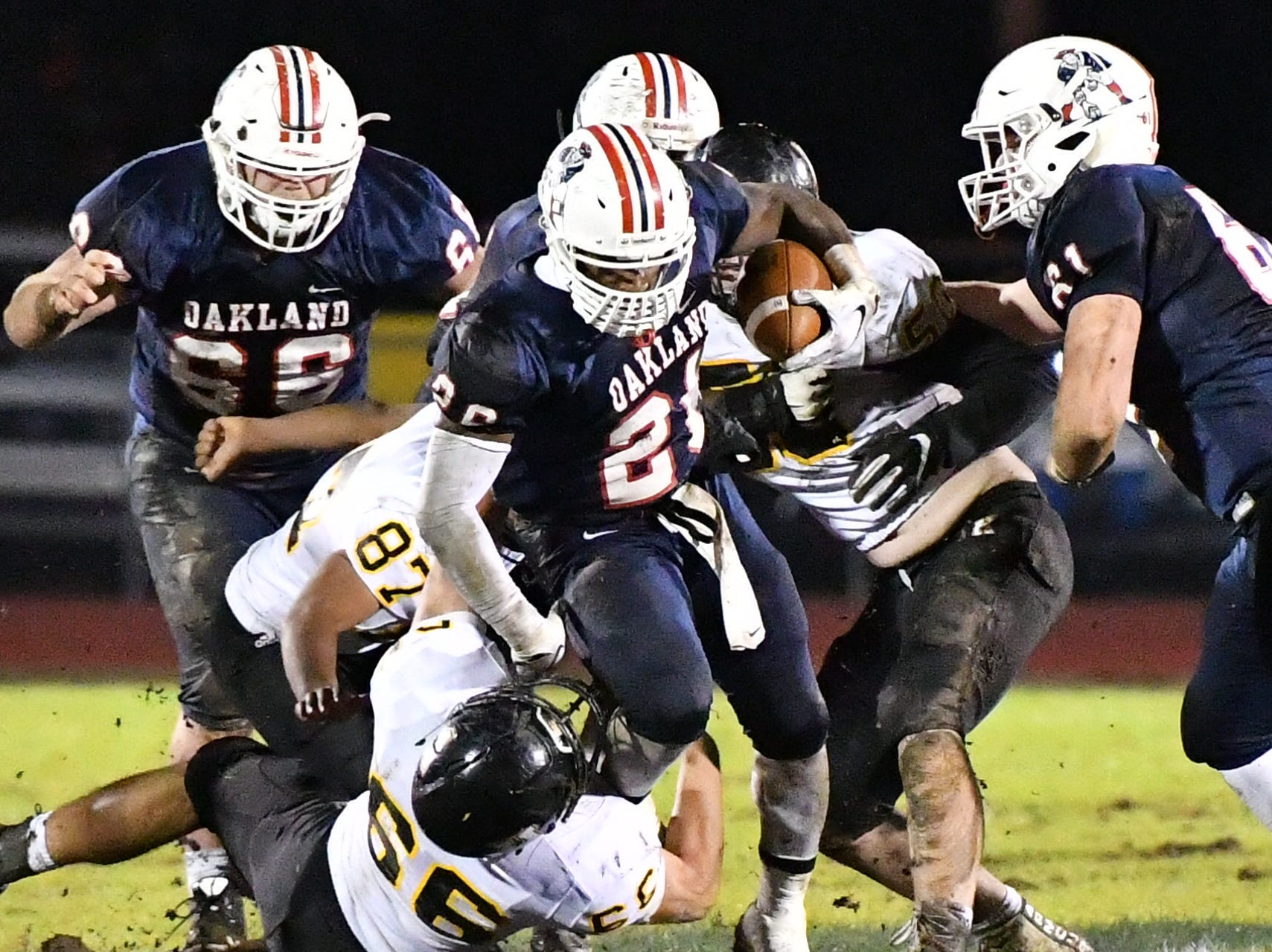 Oakland's Xavier Myers tries to break loose on a rush against Hendersonville Friday night.