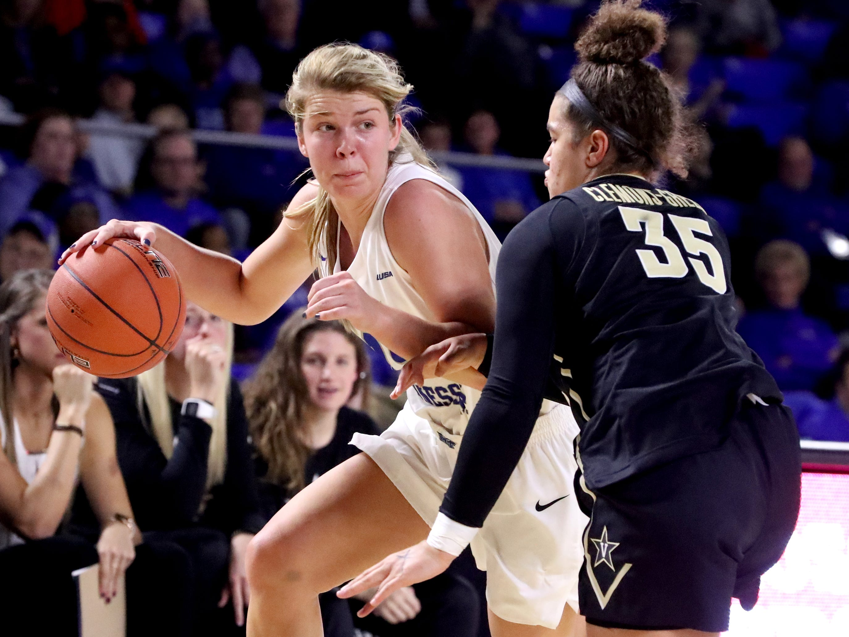 MTSU's Anna Jones(15) pushes to the basket as Vanderbilt's Kaleigh Clemons-Green (35) guards her during the women's home opening game at MTSU on Friday, Nov. 8, 2018.
